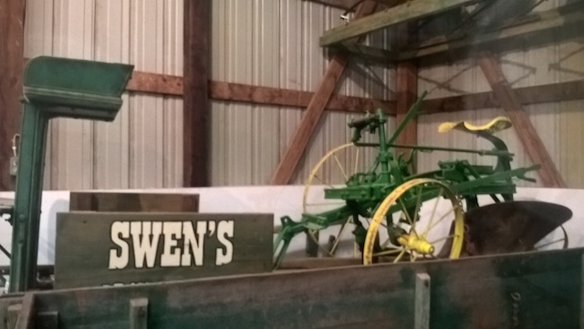 A rare left hand sulky plow on a dray wagon.