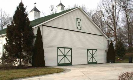 "Creative Barn Hangar with Schweiss Bi-Fold Door Holds Replica of ""Spirit of Columbus"" [PRODUCT SPOTLIGHT]"