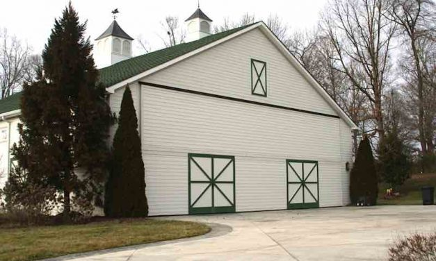 "Creative Barn Hangar with Schweiss Bi-Fold Door Holds Replica of ""Spirit of Columbus"" [PRODUCT SPOTLIGHT]"